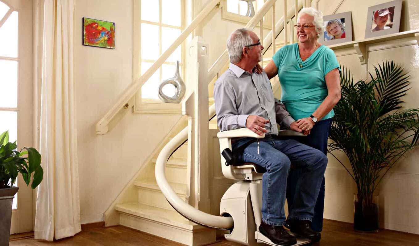 Man Sitting In A Stairlift