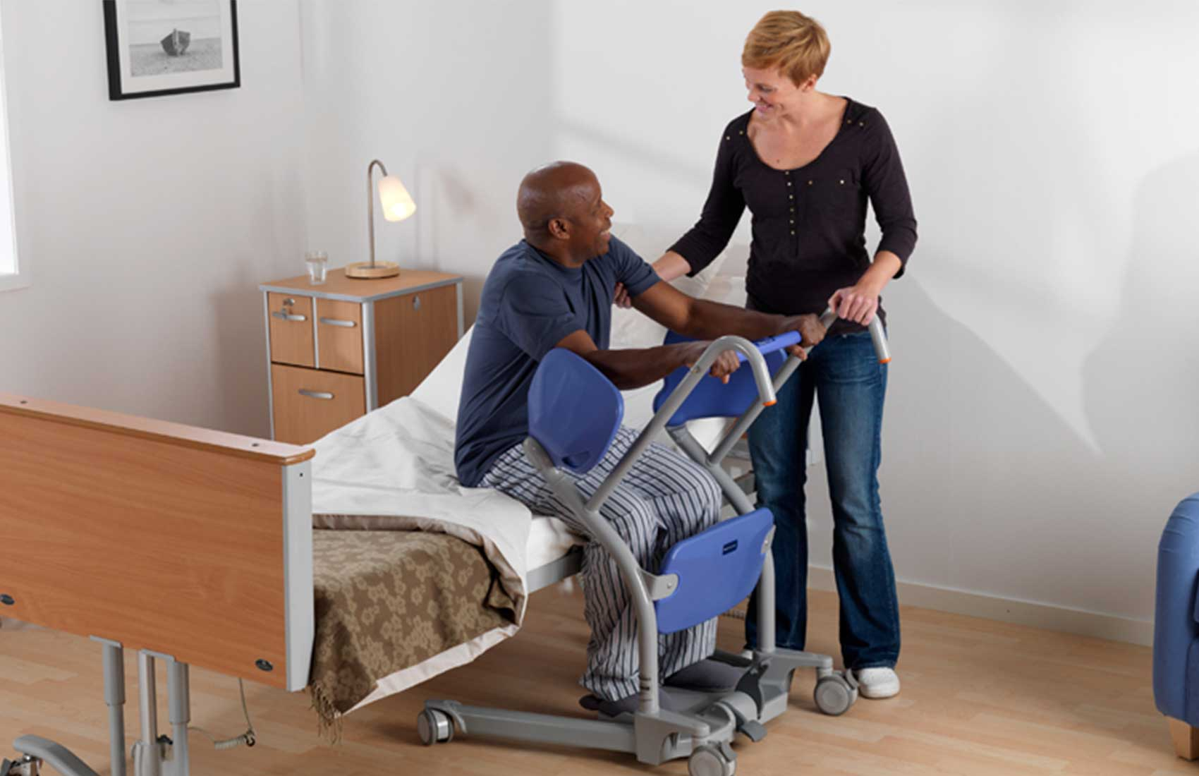 ArjoHuntleigh Products Patient Transfer Solutions Standing and Raising Aids Sara Stedy Tranfer From Bed Male Patient and Carer