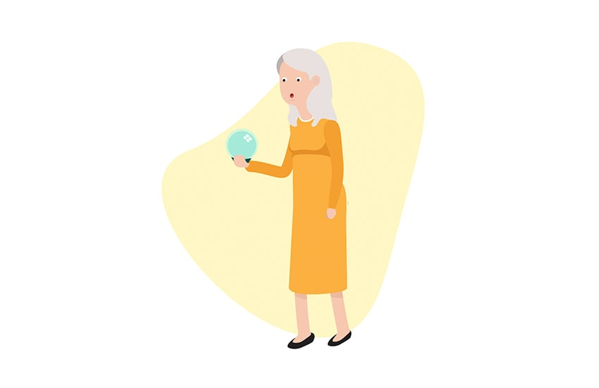 senior woman looking into a crystal ball at her future needs