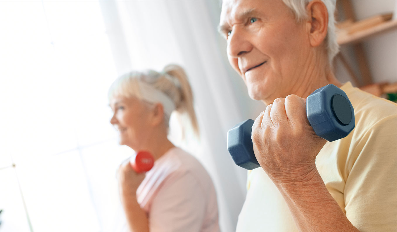 Senior Couple Working Out Together at Home