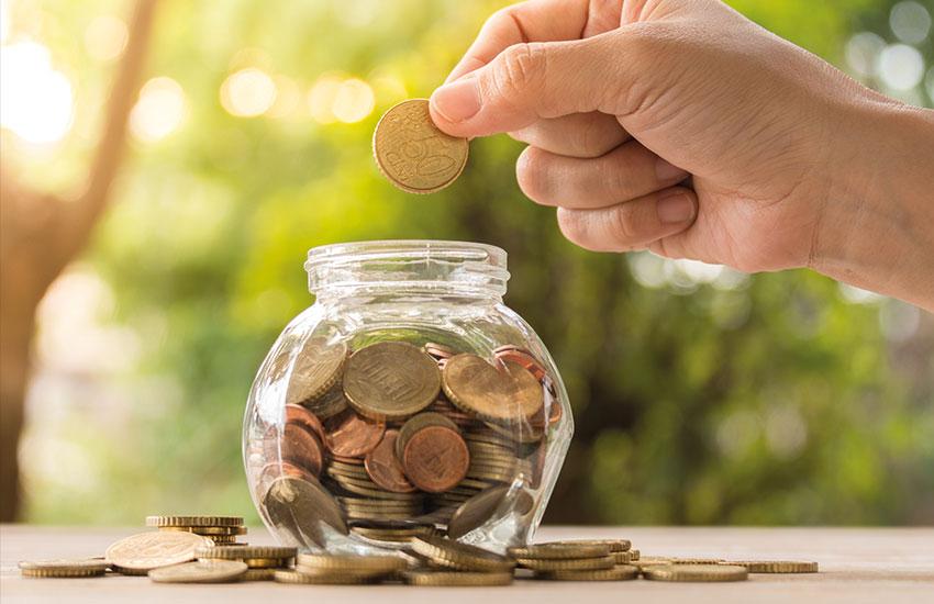 Saving money in a glass jar