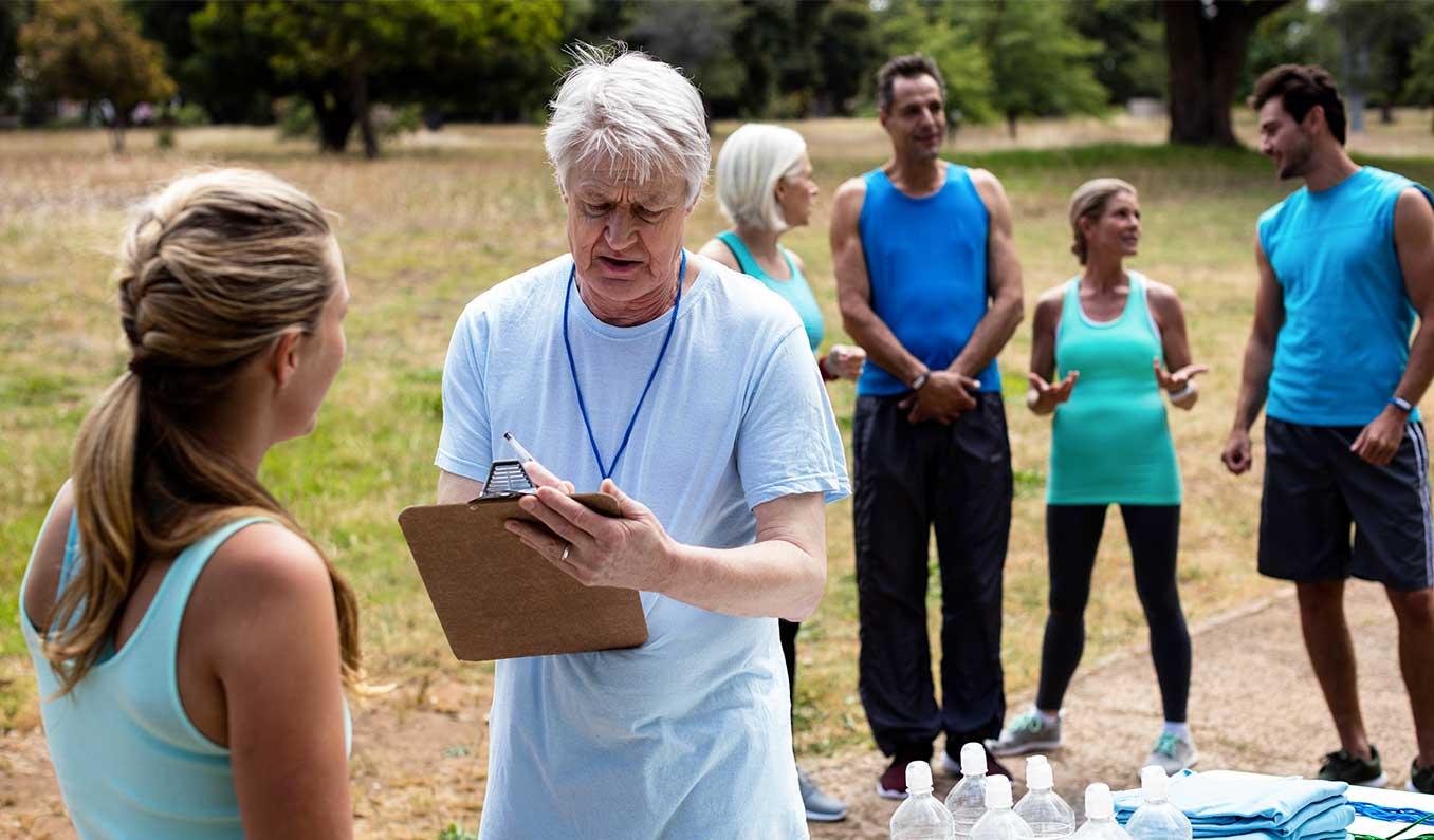 Volunteer Registering Athletes For Race