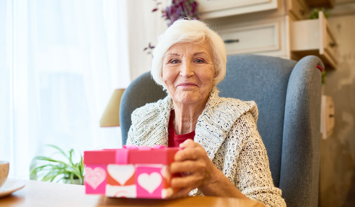 elderly woman with christmas gift