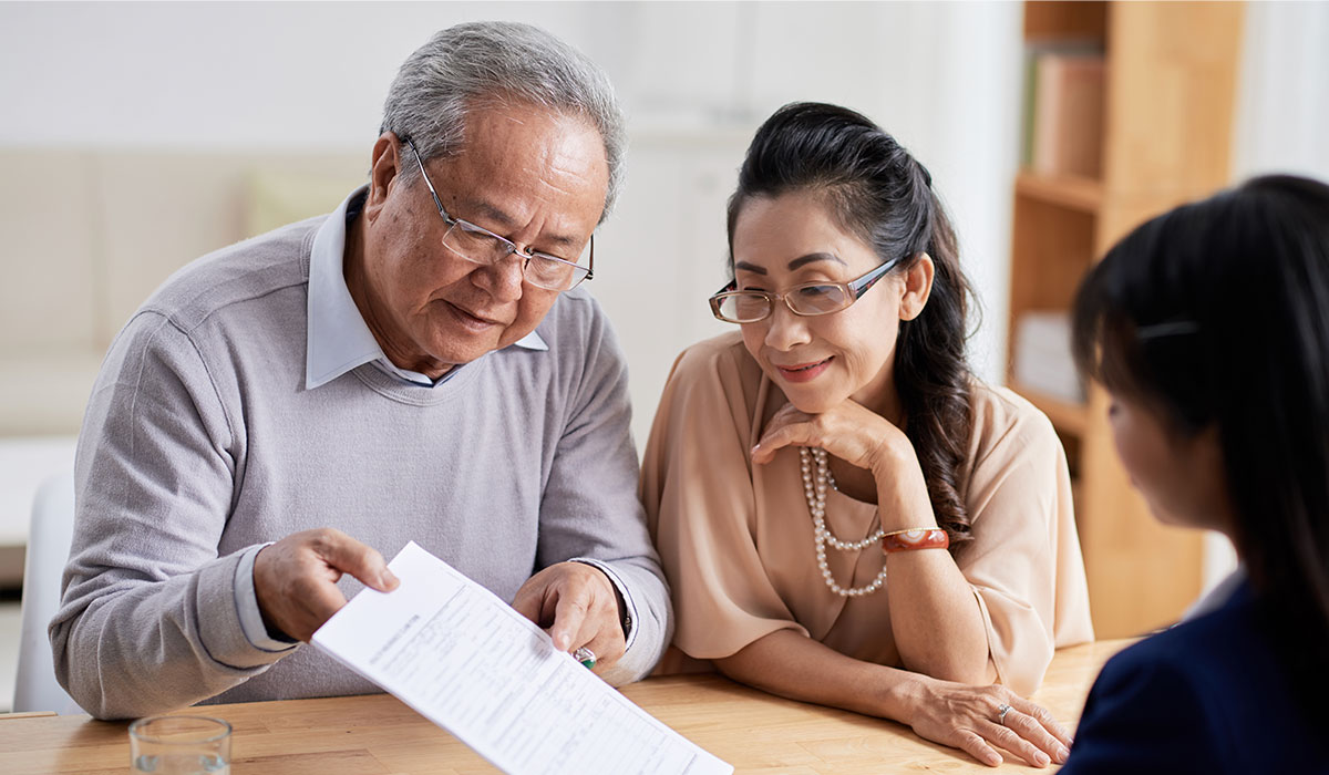 senior couple looking at estate contract